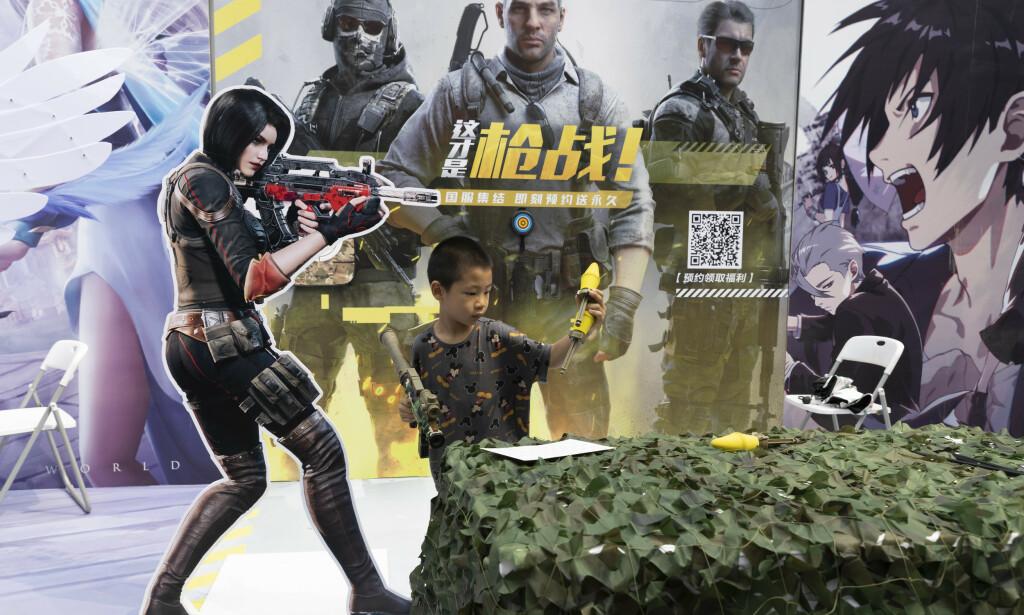 I dag er det over 110 millioner barn som spiller videospill i Kina. 📸: AP Photo/Ng Han Guan
